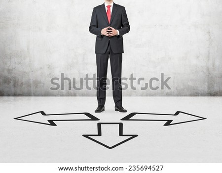 businessman standing on a cross road