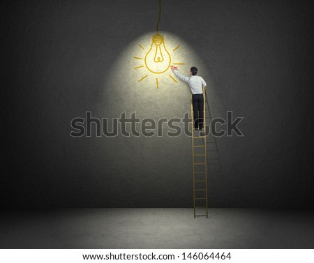 businessman standing on a ladder drawing light bulb - stock photo