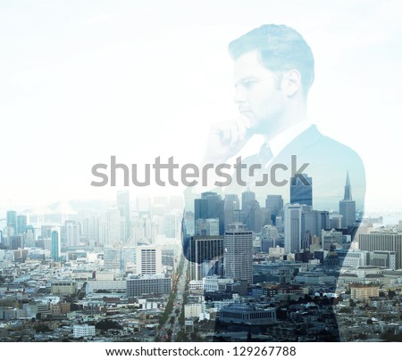 Businessman standing on background of city - stock photo