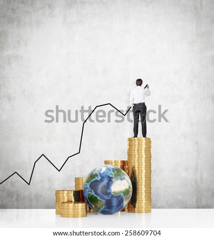 businessman standing on gold dollar coin and drawing chart. Elements of this image furnished by NASA. - stock photo