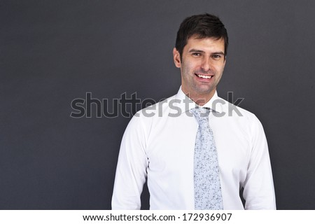 businessman standing on grey background