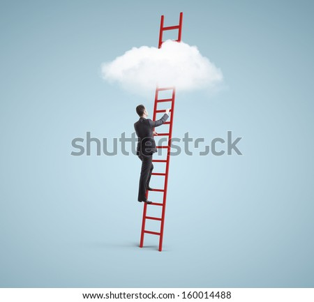 businessman standing on ladder and looking to cloud - stock photo