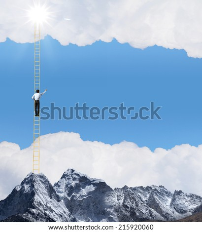Businessman standing on ladder high above mountain scene - stock photo