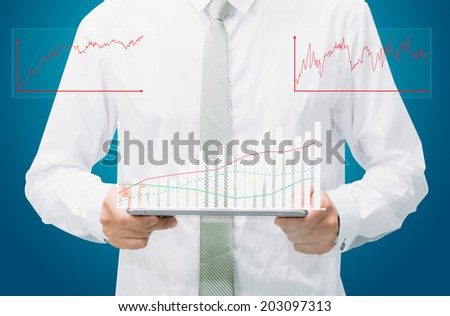 Businessman standing posture hand graph on tablet isolated on blue background