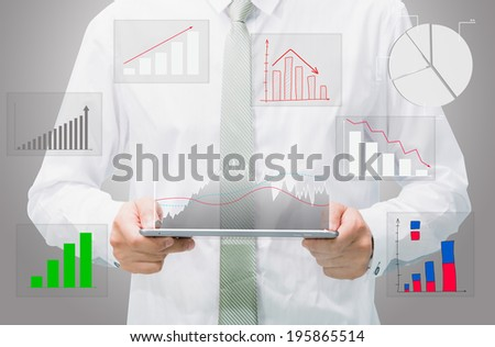 Businessman standing posture hand graph on tablet isolated on gray background - stock photo