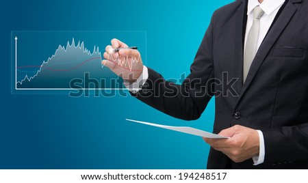 Businessman standing posture hand hold a pen isolated on blue background