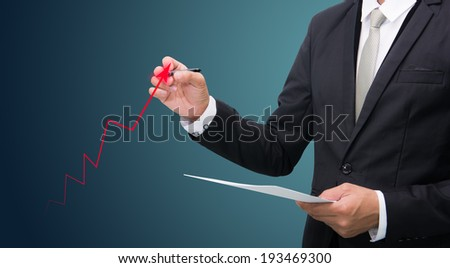 Businessman standing posture hand hold a pen isolated on dark background