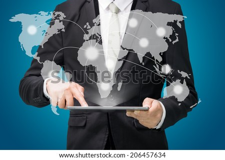 Businessman standing posture hand hold globe map on tablet isolated on blue background - stock photo