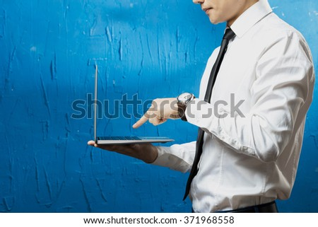 Businessman standing posture hand hold laptop