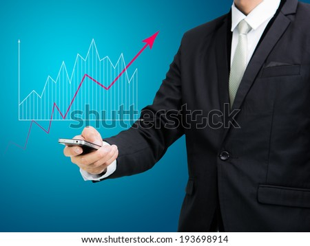 Businessman standing posture hand hold mobile phone analyze graph isolated on blue background
