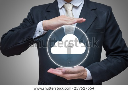 Businessman standing posture hand holding cloud computing network isolated on gray background - stock photo