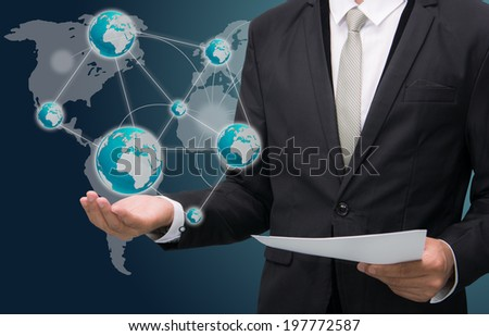 Businessman standing posture hand holding Earth icon isolated on dark background