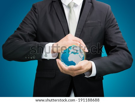 Businessman standing posture hand holding Earth icon isolated on over blue background