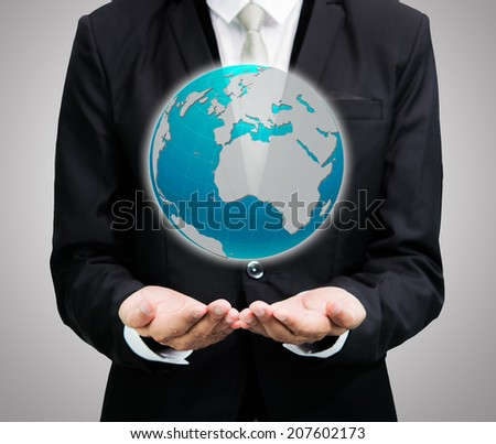 Businessman standing posture hand holding Earth icon isolated on over gray background