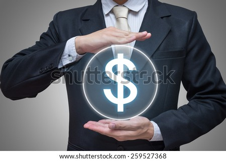 Businessman standing posture hand holding financial symbols isolated on gray background - stock photo