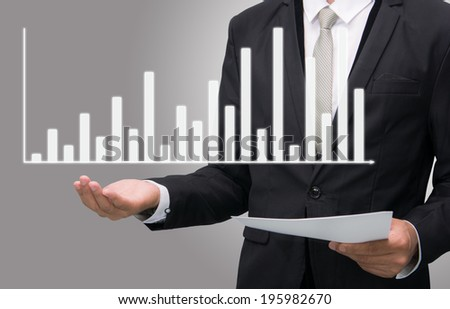 Businessman standing posture hand holding graph finance isolated on gray background