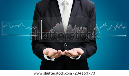 Businessman standing posture hand holding graph finance isolated on over blue background