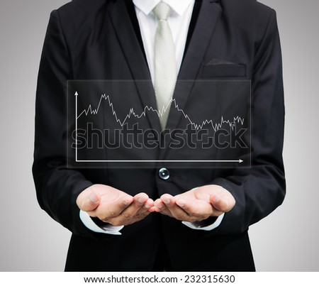 Businessman standing posture hand holding graph finance isolated on over gray background - stock photo