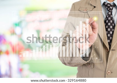 Businessman standing posture hand touch financial symbols coming - stock photo