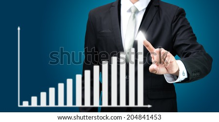 Businessman standing posture hand touch graph finance isolated on blue background
