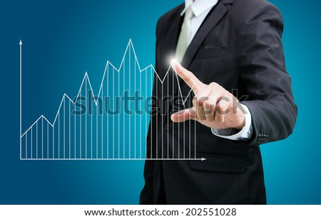 Businessman standing posture hand touch graph finance isolated on over blue background