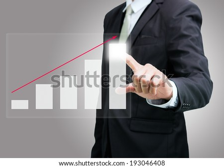 Businessman standing posture hand touch graph finance isolated on over gray background