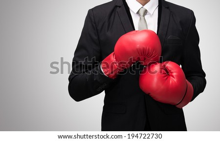 Businessman standing posture in boxing gloves isolated on over gray background - stock photo