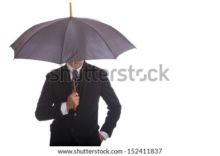 Businessman standing umbrella.