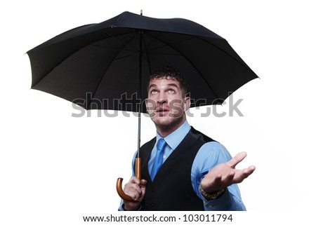 businessman standing under a umbrella shot in the studio - stock photo