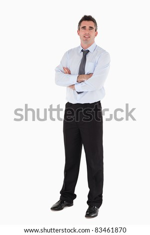 Businessman standing up with his arms crossed against a white background - stock photo