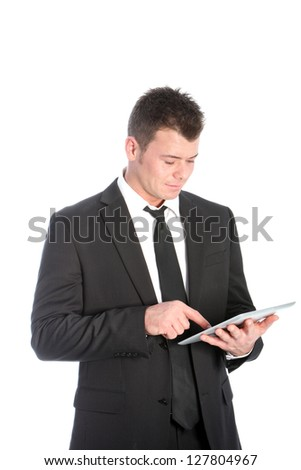 Businessman standing using a touchscreen tablet accessing information scrolling with his finger isolated on white