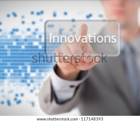 Businessman standing while pointing to the word innovations against blue graphic background