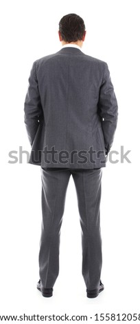 Businessman standing with back to the camera or from behind - stock photo