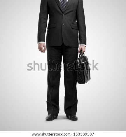 businessman standing with briefcase on white backgrounds