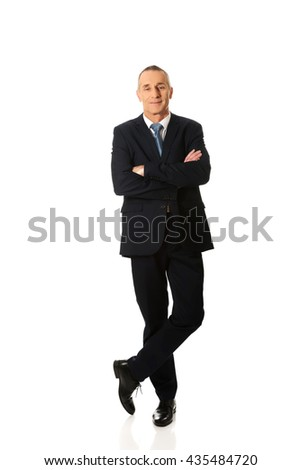 Businessman standing with folded arms - stock photo
