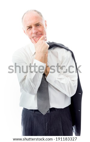 Businessman standing with hand on chin