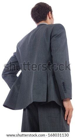 Businessman standing with hand on hip on white background