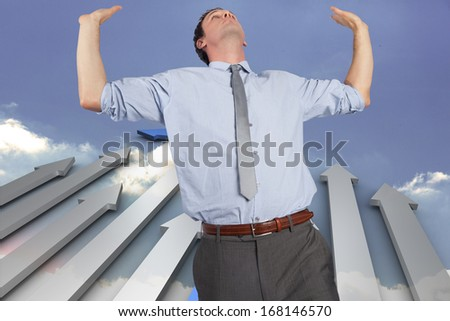 Businessman standing with hands up against steps made out of books with open door
