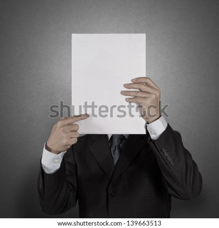 Businessman standing with on blank board as concept