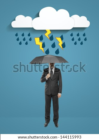 businessman standing with umbrella under abstract clouds