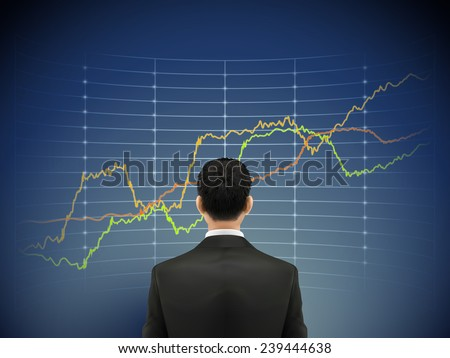 businessman stands in front of forex chart over blue background - stock photo