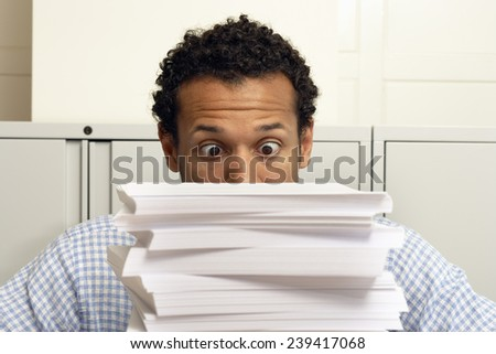 Businessman Staring at Stack of Paperwork - stock photo