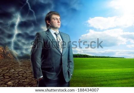 Businessman staying against bad and good weather