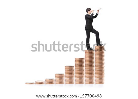 Businessman step on money and with telescope ( spyglass ) looking forward Prospects for future business. full length, isolated on white background, asian model - stock photo