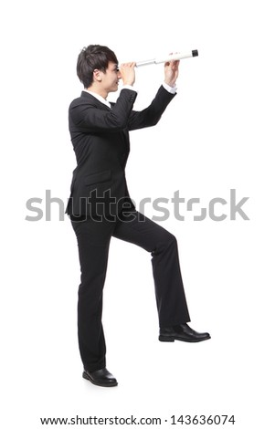 Businessman step on something and with telescope ( spyglass ) looking forward Prospects for future business. full length, isolated on white background, asian model