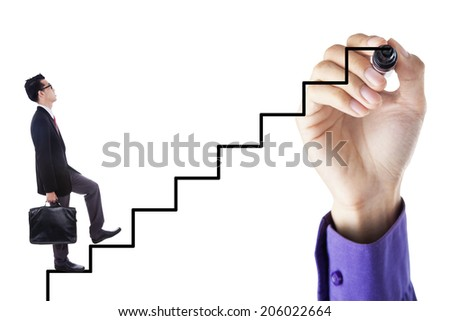 Businessman stepping up on stairs to gain his success with a hand drawing the stairs - stock photo