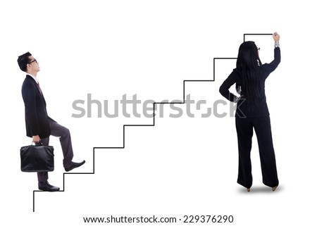 Businessman stepping up on stairs to gain his success with businesswoman drawing the stairs - stock photo