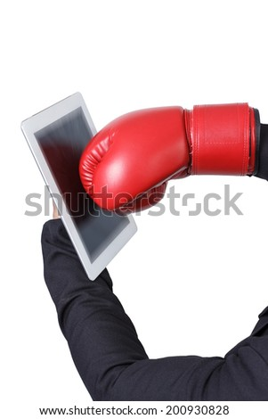 businessman sting tablet pc by boxing gloves on white background with clipping path  - stock photo