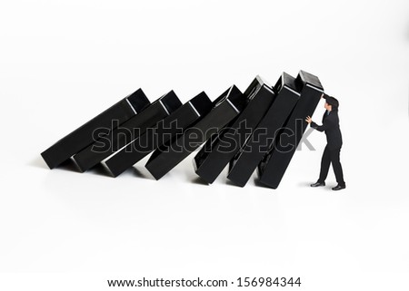 Businessman stopping the domino effect, Concept for solution to a problem by stopping the domino effect