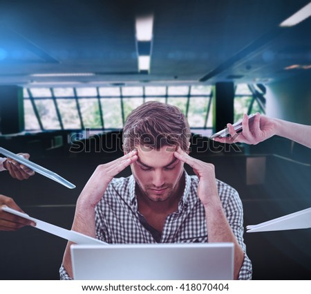Businessman stressed out at work against empty office with separate units - stock photo